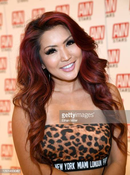 Adult film actress Tia Kai poses at the AVN Stars booth at the 2020 AVN Adult Entertainment Expo at the Hard Rock Hotel Casino on January 22 2020 in...