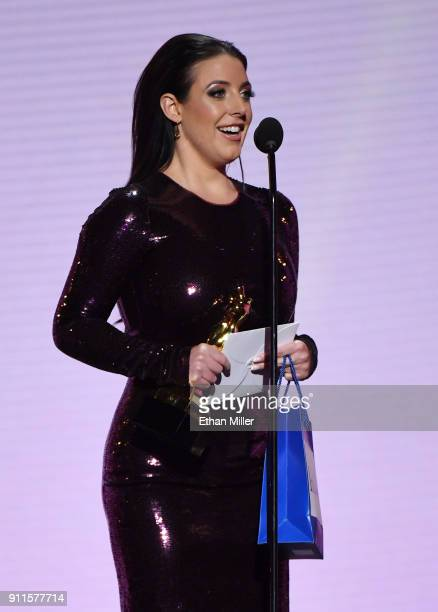 Adult film actress/director and cohost Angela White accepts the award for Female Performer of the Year during the 2018 Adult Video News Awards at The...