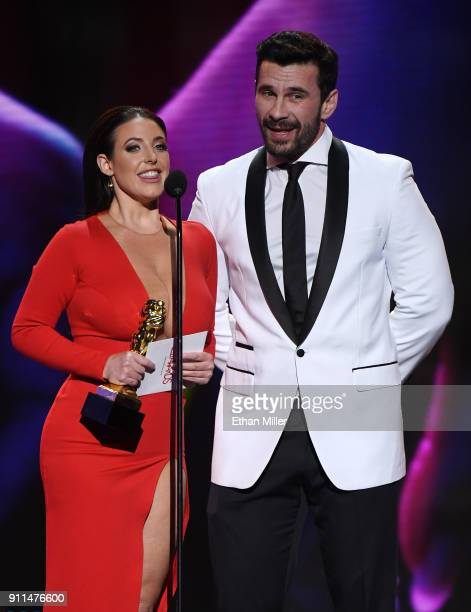 Adult film actress/director and co-host Angela White and adult film actor/director Manuel Ferrara accept the award for Best Boy/Girl Sex Scene during...