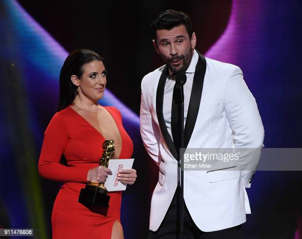 Adult film actress/director and cohost Angela White and adult film actor/director Manuel Ferrara accept the award for Best Boy/Girl Sex Scene during...