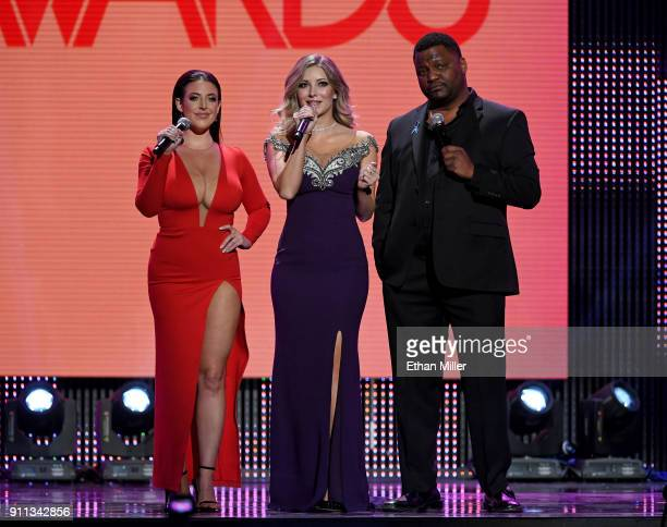 Adult film actress/director Angela White webcam model Harli Lotts and actor/comedian Aries Spears cohost the 2018 Adult Video News Awards at The...