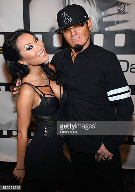 Adult film actress/director Asa Akira and Wicked Pictures publicist Daniel Metcalf appear at the Wicked Pictures booth at the 2017 AVN Adult...
