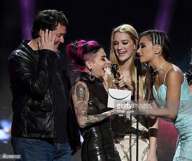 Adult film actress/director Joanna Angel accepts the award for Best Supporting Actress from comedian/actor Doug Benson and adult film actresses Kenna...