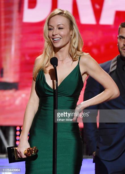 Adult film actress/director Kayden Kross accepts the award for Best Drama for After Dark during the 2019 Adult Video News Awards at The Joint inside...