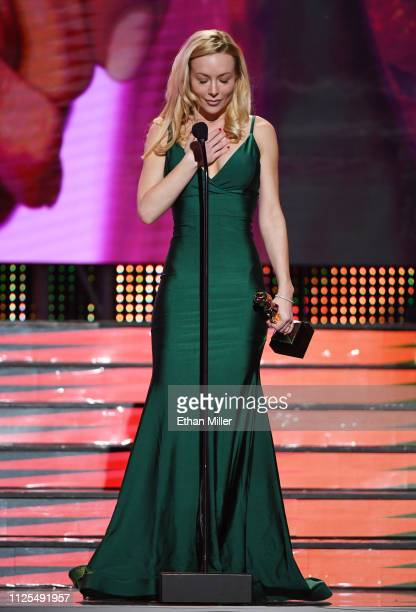 Adult film actress/director Kayden Kross accepts the award for Director of the Year during the 2019 Adult Video News Awards at The Joint inside the...