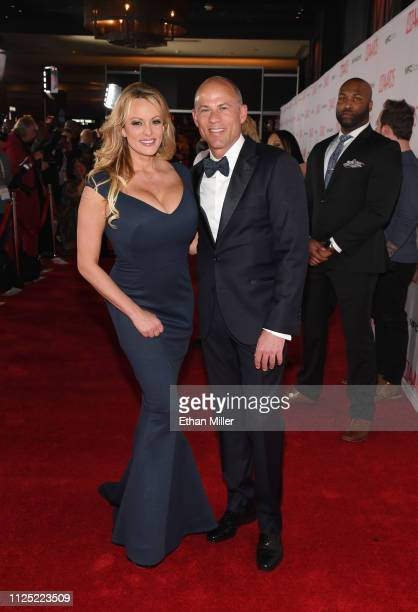 Adult film actress/director Stormy Daniels and attorney Michael Avenatti attend the 2019 Adult Video News Awards at The Joint inside the Hard Rock...
