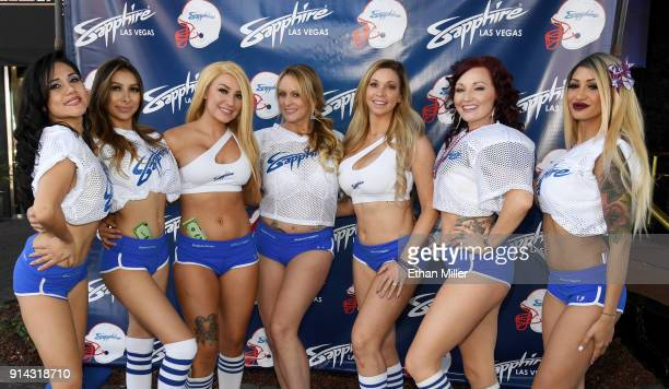 Adult film actress/director Stormy Daniels poses with dancers as she hosts a Super Bowl party at Sapphire Las Vegas Gentlemen's Club on February 4...