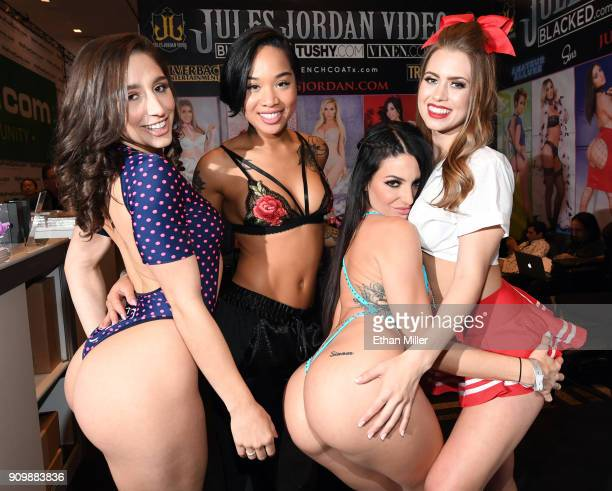 Adult film actresses Abella Danger Honey Gold Kissa Sins and Jill Kassidy pose at the Jules Jordan Video booth at the 2018 AVN Adult Entertainment...