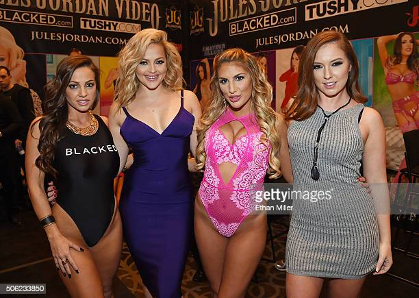 Adult film actresses Abigail Mac Alexis Texas August Ames and Maddy O'Reilly pose at the Jules Jordan Video booth at the 2016 AVN Adult Entertainment...