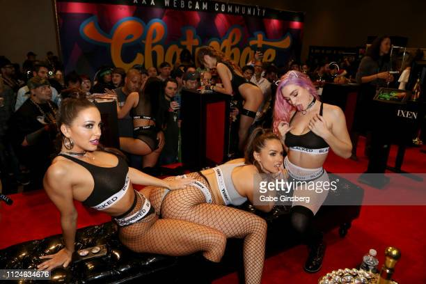 Adult film actresses Abigail Mac, Tori Black and Kendra Sunderland pose in Greg Lansky's Blacked, Tushy and Vixen adult studios booth at the 2019 AVN...