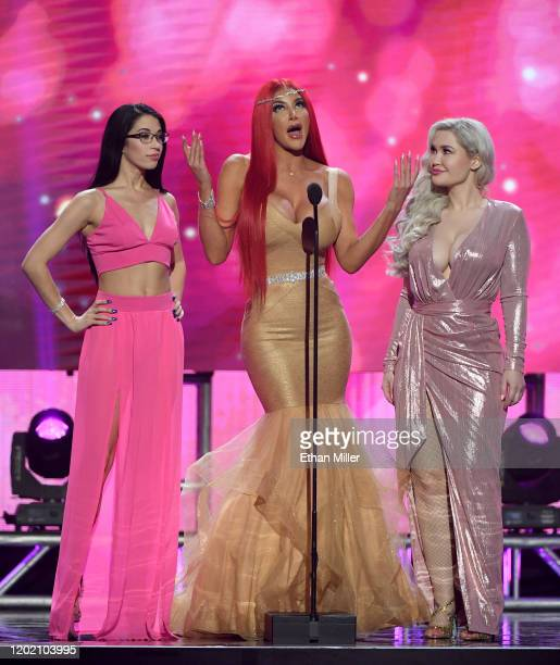 Adult film actresses Alex Coal Nicolette Shea and Violet Doll present an award during the 2020 Adult Video News Awards at The Joint inside the Hard...