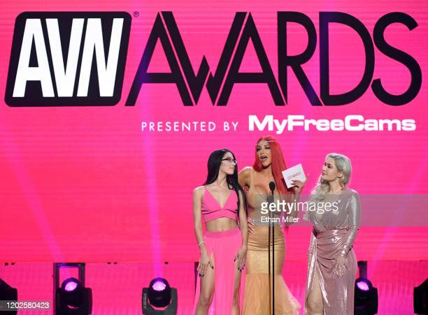 Adult film actresses Alex Coal, Nicolette Shea and Violet Doll present an award during the 2020 Adult Video News Awards at The Joint inside the Hard...