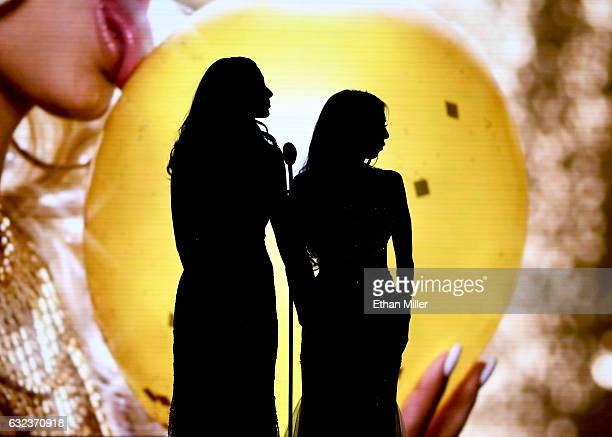Adult film actresses Ariana Marie and Kat Dior are silhouetted on stage as they present an award during the 2017 Adult Video News Awards at The Joint...
