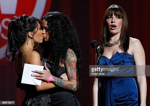 Adult film actresses Asa Akira and Angelina Valentine kiss as Dana DeArmond looks on as they present an award during the 27th annual Adult Video News...