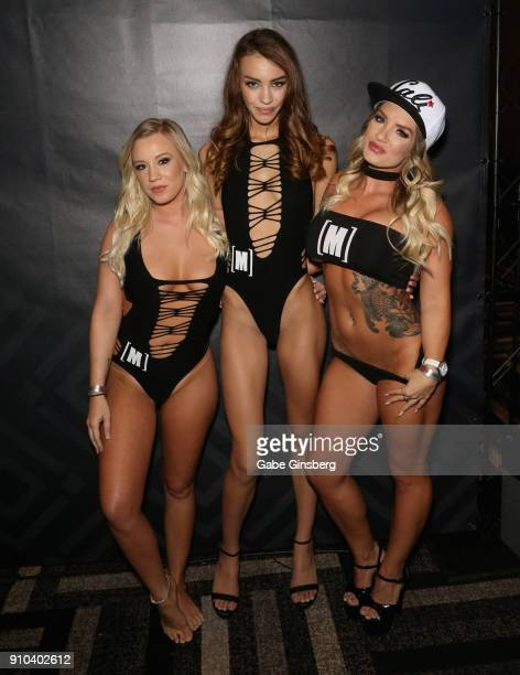 Adult film actresses Bailey Brooke Charity Crawford and Cali Carter pose in the Mofos booth during the 2018 AVN Adult Expo at the Hard Rock Hotel...