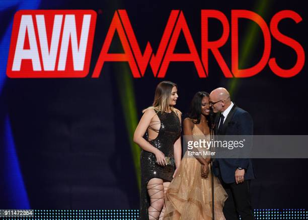 Adult film actresses Blair Williams and Jezabel Vessir and adult film actor Derrick Pierce present an award during the 2018 Adult Video News Awards...