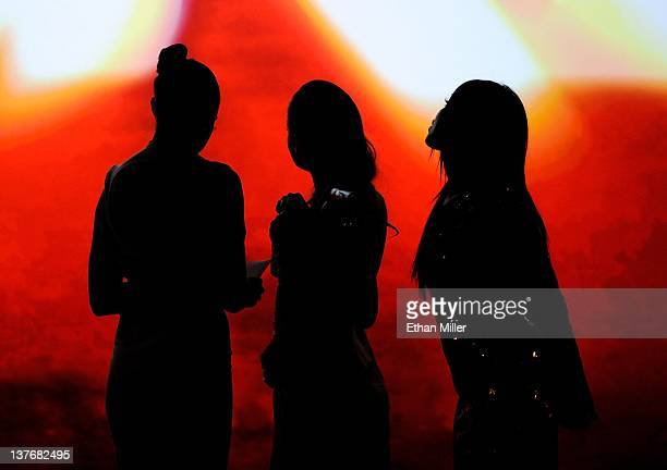 Adult film actresses Chanel Preston Allie Haze and Selena Rose are silhouetted onstage as they present awards during the 29th annual Adult Video News...