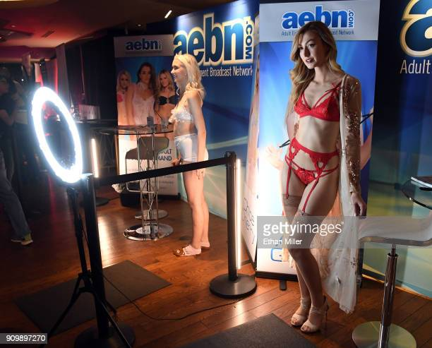 Adult film actresses Chloe Cherry and Alexa Grace pose for photos at the Adult Entertainment Broadcast Network booth at the 2018 AVN Adult...