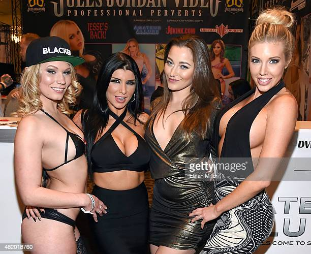 Adult film actresses Dakota James, Romi Rain, Dani Daniels and Samantha Saint pose at the Jules Jordan Video booth at the 2015 AVN Adult...