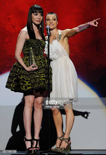 Adult film actresses Dana DeArmond and Belladonna accept an award during the 29th annual Adult Video News Awards Show at The Joint inside the Hard...