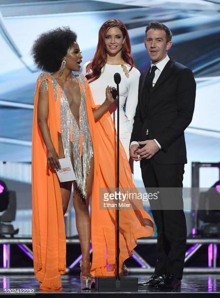 Adult film actresses Demi Sutra and Jayden Cole and adult film director producer and actor Danny D present an award during the 2020 Adult Video News...