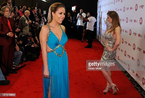 Adult film actresses Ella Milano and Emily Addison arrive at the 29th annual Adult Video News Awards Show at the Hard Rock Hotel Casino January 21...