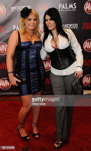 Adult film actresses Flower Tucci and Olivia O'Lovely arrive at the 27th annual Adult Video News Awards Show at the Palms Casino Resort January 9...