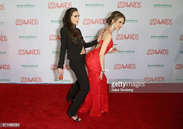 Adult film actresses Gia Paige and Kimmy Granger joke around during the 2018 Adult Video News Awards at the Hard Rock Hotel & Casino on January 27,...