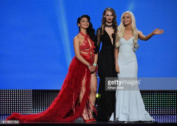 Adult film actresses Gina Valentina Jillian Janson and Elsa Jean present an award during the 2018 Adult Video News Awards at The Joint inside the...