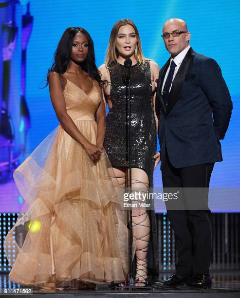 Adult film actresses Jezabel Vessir and Blair Williams and adult film actor Derrick Pierce present an award during the 2018 Adult Video News Awards...