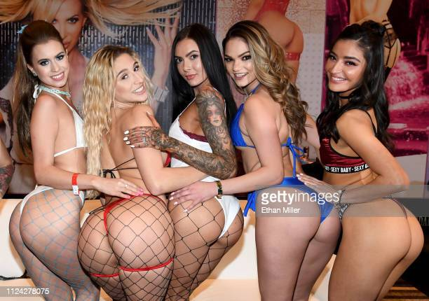 Adult film actresses Jill Kassidy Abella Danger Marley Brinx Athena Faris and Emily Willis pose at the Jules Jordan Video booth at the 2019 AVN Adult...