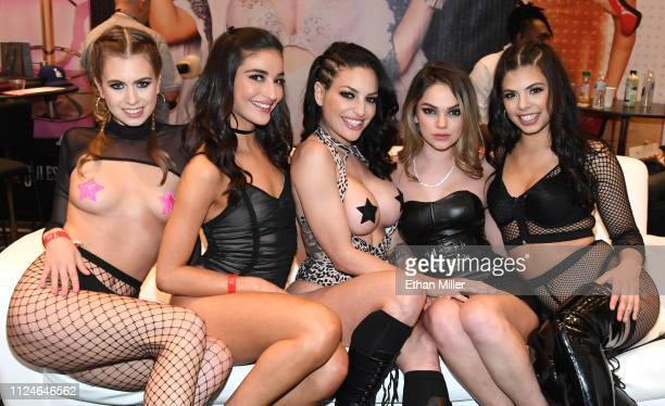 Adult film actresses Jill Kassidy Emily Willis Kissa Sins Athena Faris and Gina Valentina pose at the Jules Jordan Video booth at the 2019 AVN Adult...
