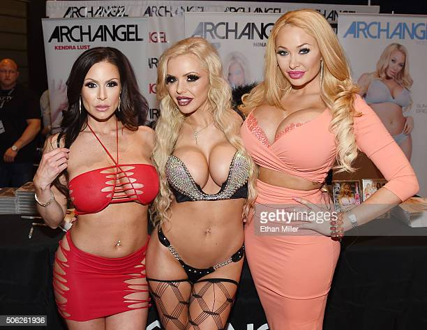 Adult film actresses Kendra Lust Nina Elle and Summer Brielle pose at the ArchAngel booth at the 2016 AVN Adult Entertainment Expo at The Joint...