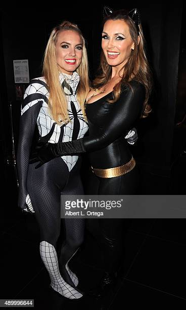 Adult film actresses Kiera Nicole and Tanya Tate as Catwoman at FSC After Dark 'Capes Panties' A Superhero Costume Lingerie Auction and Silent...