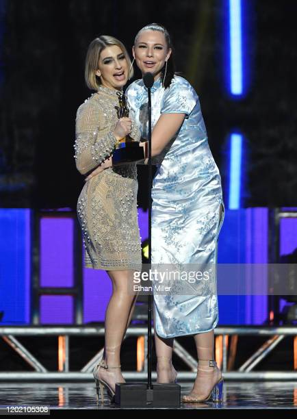Adult film actresses Kristin Scott and Aidra Fox accept the award for Best Girl/Girl Sex Scene during the 2020 Adult Video News Awards at The Joint...