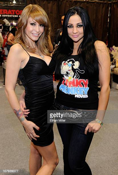 Adult film actresses Monique Alexander and Audrey Bitoni appear at the Funky Monkey Movies booth at the 2011 AVN Adult Entertainment Expo at the...