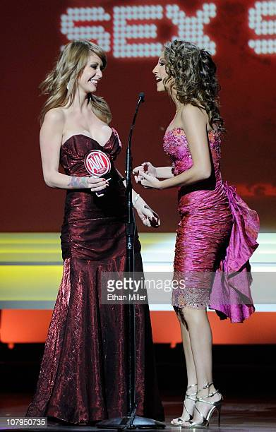 Adult film actresses Monique Alexander and Jenna Haze react after winning an award at the 28th annual Adult Video News Awards Show at The Pearl...