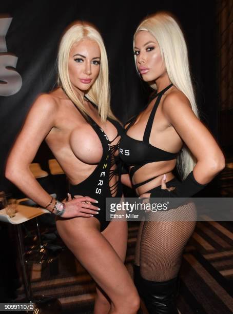 Adult film actresses Nicolette Shea and Bridgette B pose at the Brazzers booth at the 2018 AVN Adult Entertainment Expo at the Hard Rock Hotel &...