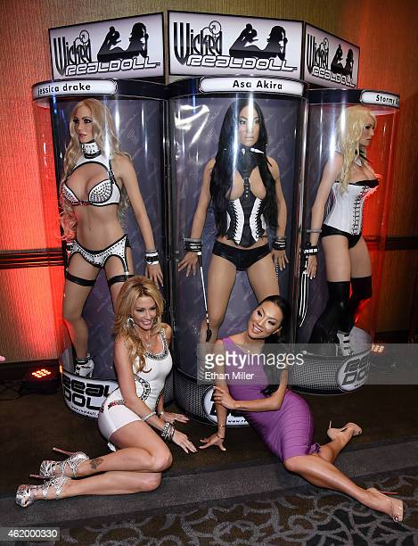 Adult film actresses/directors jessica drake and Asa Akira pose with their Wicked RealDolls at the 2015 AVN Adult Entertainment Expo at the Hard Rock...
