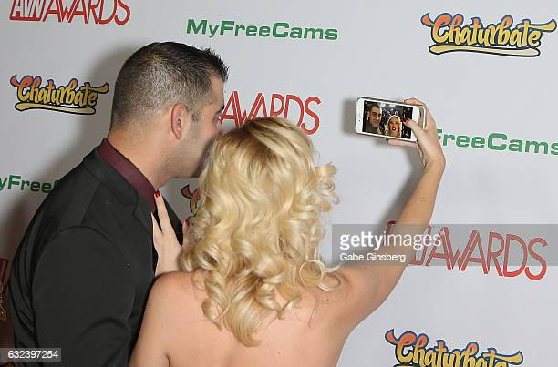 Adult film director Alan E of Stills by Alan and adult film actress Samantha Rone take a selfie as they attend the 2017 Adult Video News Awards at...