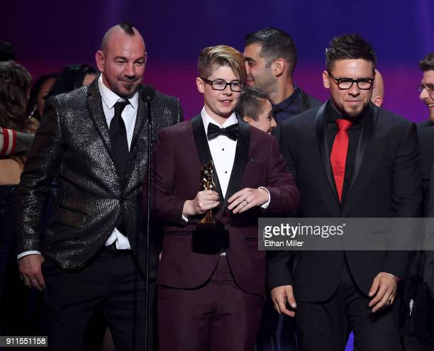 Adult film director Craven Moorehead and adult film directors/producers Bree Mills and Billy Visual accept the award for Movie of the Year during the...