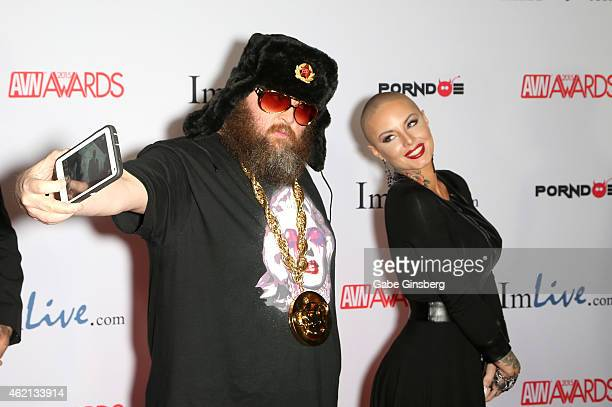 Adult film director Ivan takes a cell phone picture with adult film actress Christy Mack as they arrive at the 2015 Adult Video News Awards at the...