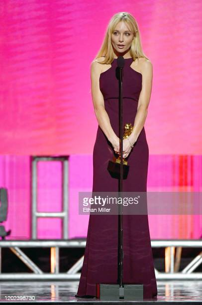 Adult film director/actress Kayden Kross accepts the award for Director of the Year during the 2020 Adult Video News Awards at The Joint inside the...