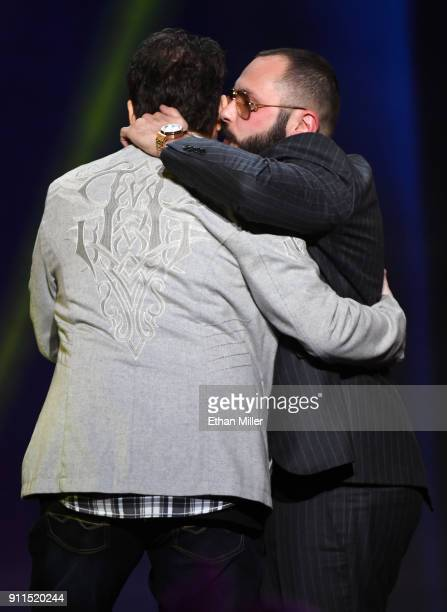 Adult film director/producer Kevin Moore is hugged after being brought onstage by adult film director/producer Greg Lansky to speak about Moore's...