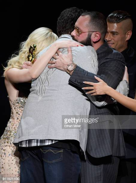 Adult film director/producer Kevin Moore is hugged after speaking about his late wife adult film actress August Ames during the 2018 Adult Video News...