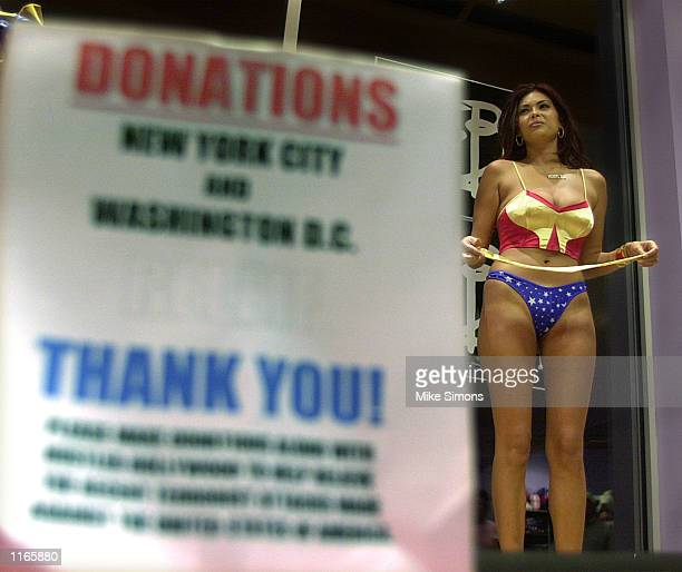 Adult film magazine and Internet star Tera Patrick auctions off a Wonderwoman outfit at Hustler Hollywood September 22 2001 in Monroe OH The store...