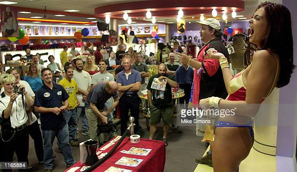 Adult film, magazine and Internet star Tera Patrick auctions off a Wonderwoman outfit at Hustler Hollywood September 22, 2001 in Monroe, OH. The...