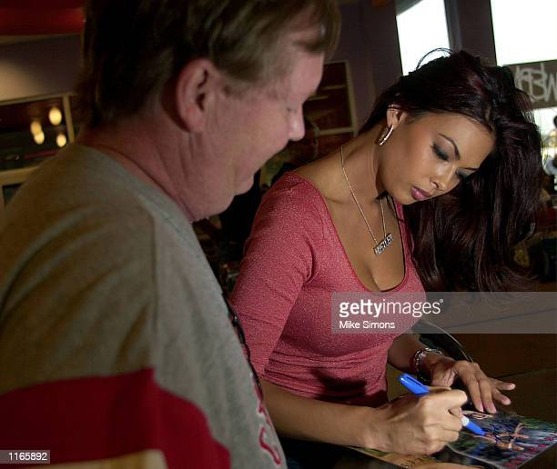 Adult film magazine and Internet star Tera Patrick signs an autograph at Hustler Hollywood September 22 2001 in Monroe OH The store collected money...