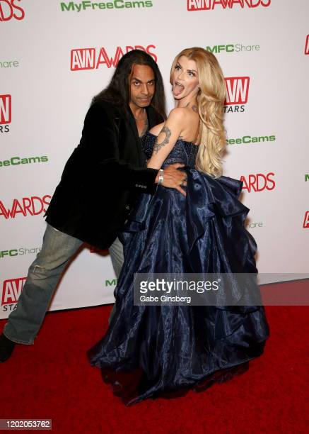 Adult film producer Big Chief Quarterblack photobombs adult film actress Joslyn James during the 2020 Adult Video News Awards at The Joint inside the...