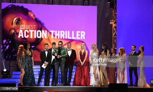 Adult film producer/director Axel Braun and cast members accept the award for Best Action/Thriller for The Possession of Mrs Hyde during the 2019...